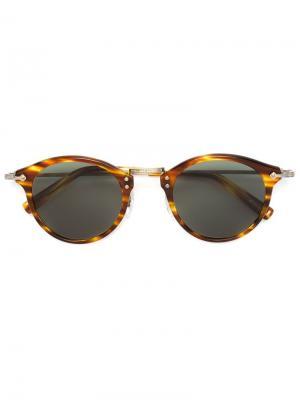 Солнцезащитные очки с круглой оправой Masunaga. Цвет: коричневый