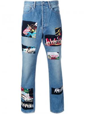 Зауженные книзу джинсы с нашивками Doublet. Цвет: синий