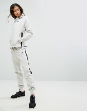 Nike Флисовые джоггеры Tech. Цвет: кремовый