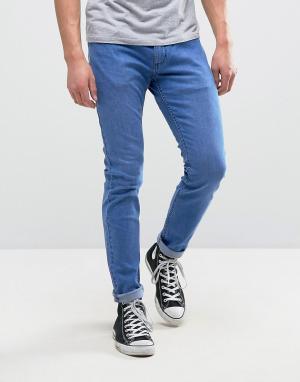 Rollas Узкие эластичные джинсы с отворотами Rollies. Цвет: синий