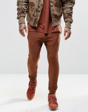 Other UK Зауженные джоггеры с заниженным шаговым швом. Цвет: коричневый