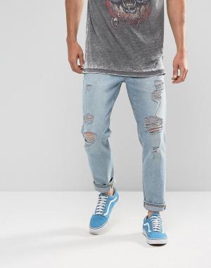 ASOS Светлые рваные джинсы из переработанного денима. Цвет: синий
