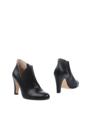 Полусапоги и высокие ботинки NORA. Цвет: черный