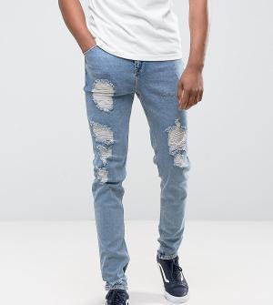 ASOS Голубые суженные книзу джинсы с рваной отделкой TALL. Цвет: синий