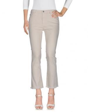 Джинсовые брюки AG ADRIANO GOLDSCHMIED. Цвет: слоновая кость