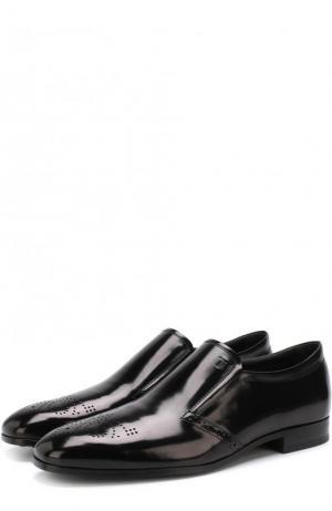 Кожаные лоферы с брогированием и эластичными вставками Tod's. Цвет: черный
