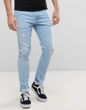 ASOS Голубые выбеленныые джинсы суперскинни с рваной отделкой. Цвет: синий