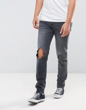 ASOS Черные винтажные джинсы скинни с рваной отделкой. Цвет: черный