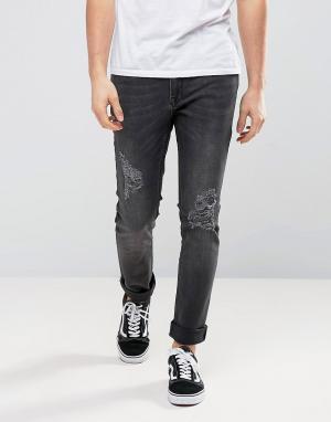 Zeffer Выбеленные эластичные черные джинсы скинни с рваной отделкой. Цвет: черный