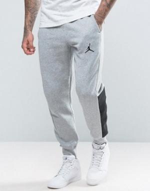 Jordan Джоггеры с логотипом Nike 834375-063. Цвет: серый