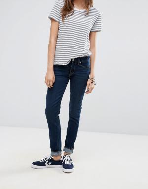 Levis Зауженные джинсы цвета индиго с классической талией 711. Цвет: синий