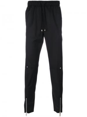 Спортивные брюки с молниями Icosae. Цвет: чёрный
