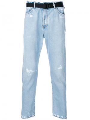 Зауженные к низу джинсы с эффектом потертости Off-White. Цвет: синий