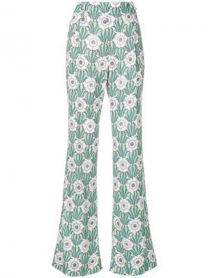 Расклешенные брюки с цветочным принтом Prada. Цвет: зелёный