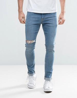 ASOS Синие выбеленные джинсы скинни с прорехами. Цвет: синий