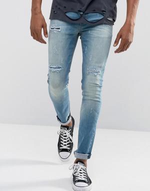 ASOS Выбеленные синие супероблегающие джинсы с рваной отделкой и накладками. Цвет: синий