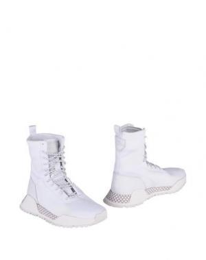 Полусапоги и высокие ботинки ADIDAS ORIGINALS. Цвет: белый