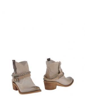 Полусапоги и высокие ботинки OVYE' by CRISTINA LUCCHI. Цвет: бежевый