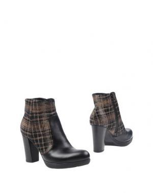 Полусапоги и высокие ботинки GIONATA. Цвет: черный