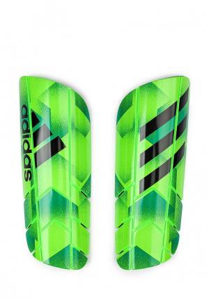 Щитки adidas Performance. Цвет: зеленый