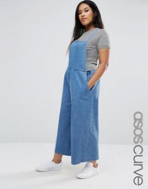 ASOS Curve Укороченный джинсовый комбинезон. Цвет: синий