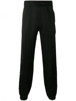 Спортивные брюки с полосатой окантовкой Marc Jacobs. Цвет: чёрный