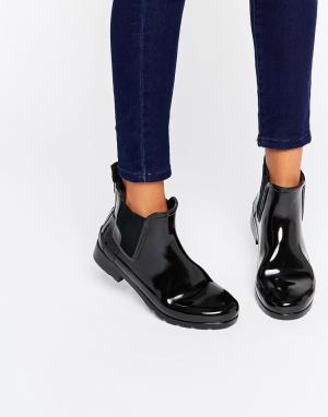 Hunter Черные блестящие резиновые ботинки челси Original. Цвет: черный