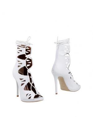 Полусапоги и высокие ботинки OVYE' by CRISTINA LUCCHI. Цвет: белый