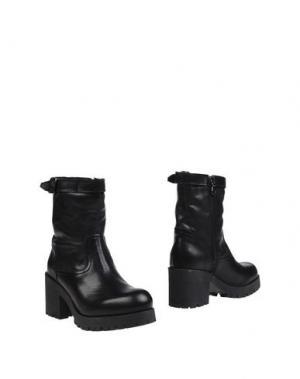 Полусапоги и высокие ботинки NANNINI. Цвет: черный