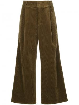 Расклешенные брюки Estnation. Цвет: коричневый