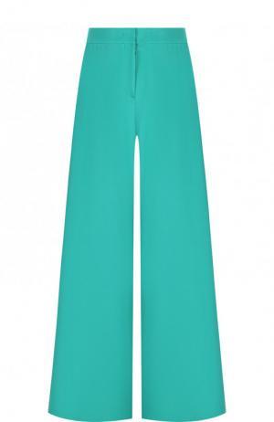 Широкие однотонные брюки из шелка Emilio Pucci. Цвет: зеленый