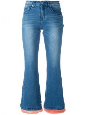 Расклешенные джинсы с ворсистым подолом Steve J & Yoni P. Цвет: синий