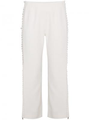 Укороченные брюки со шнуровкой сбоку Jonathan Simkhai. Цвет: телесный