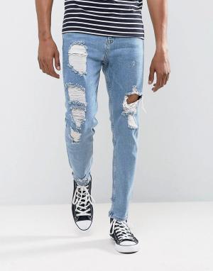 ASOS Голубые суженные книзу джинсы с рваной отделкой. Цвет: синий