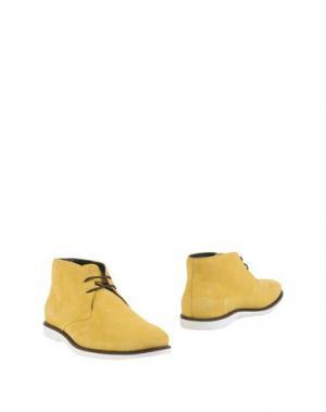 Полусапоги и высокие ботинки HOGAN. Цвет: желтый