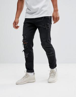 ASOS Суженные книзу черные выбеленные джинсы с рваной отделкой из денима пл. Цвет: черный