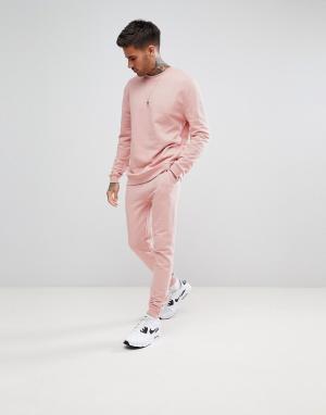 ASOS Розовый спортивный костюм со свитшотом и джоггерами скинни. Цвет: розовый