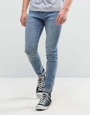 Rollas Выбеленные супероблегающие джинсы Stinger. Цвет: синий