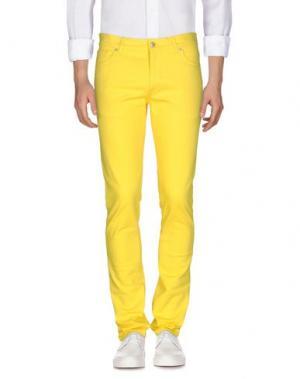 Джинсовые брюки MOSCHINO COUTURE. Цвет: желтый