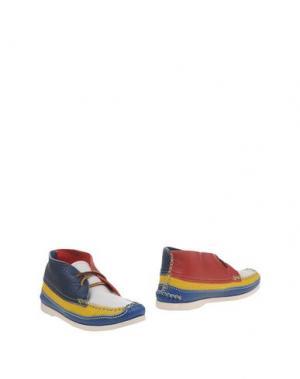 Полусапоги и высокие ботинки YUKETEN. Цвет: желтый