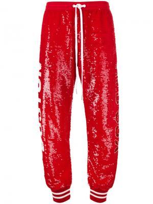 Спортивные брюки с отделкой пайетками Ashish. Цвет: красный