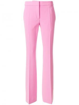 Расклешенные брюки слим Moschino. Цвет: розовый и фиолетовый