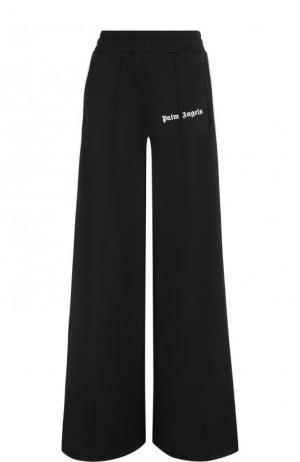 Расклешенные брюки с карманами и лампасами Palm Angels. Цвет: черный