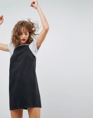 ASOS Выбеленное черное джинсовое платье-комбинация с люверсами DESIGN. Цвет: черный