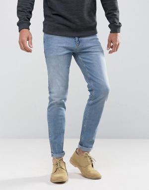 ASOS Синие светлые джинсы скинни. Цвет: синий