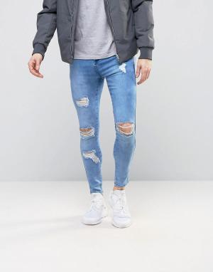 SikSilk Суперзауженные джинсы с рваной отделкой. Цвет: синий