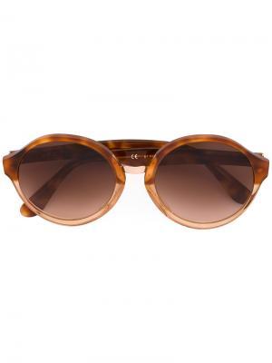 Солнцезащитные очки в круглой оправе Retrosuperfuture. Цвет: жёлтый и оранжевый
