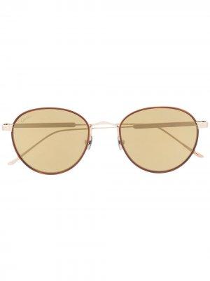 Солнцезащитные очки в круглой оправе Cartier Eyewear. Цвет: золотистый