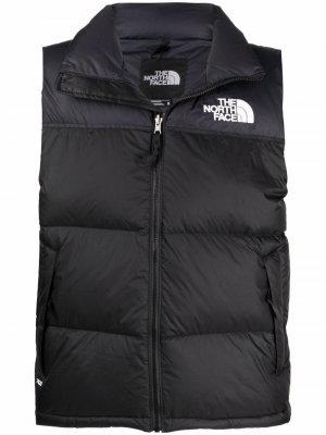 Дутый жилет с логотипом The North Face. Цвет: черный
