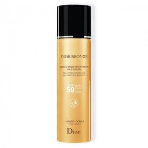 Солнцезащитное молочко-дымка Bronze Dior. Цвет: бесцветный